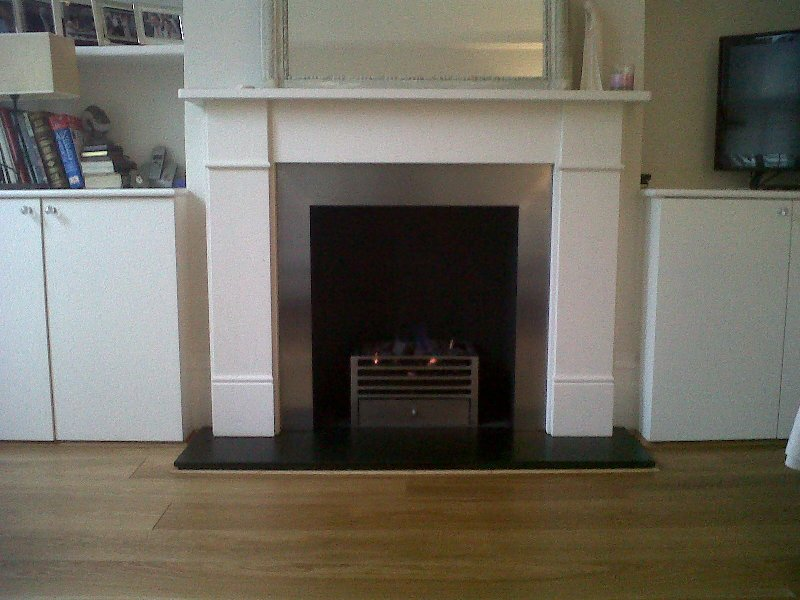 Classic limestone fire surround with stainless steel slips