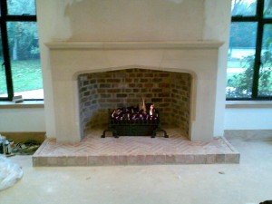 Large Tudor Limestone Fireplace in Guildford complete with basket