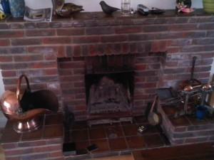 Unfashionable red brick fireplace waiting for replacement